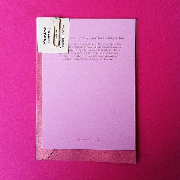"""Pink postcard featuring """"Again and Again"""" poem by Rainer Maria Rilke"""