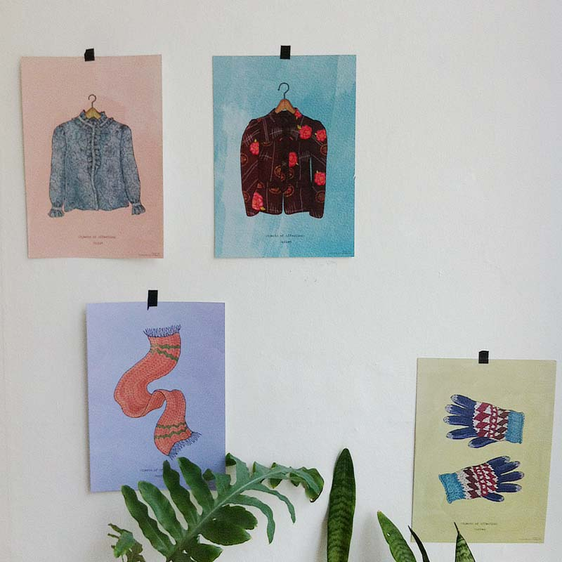 """Objects of Affection"" prints pasted on the wall"