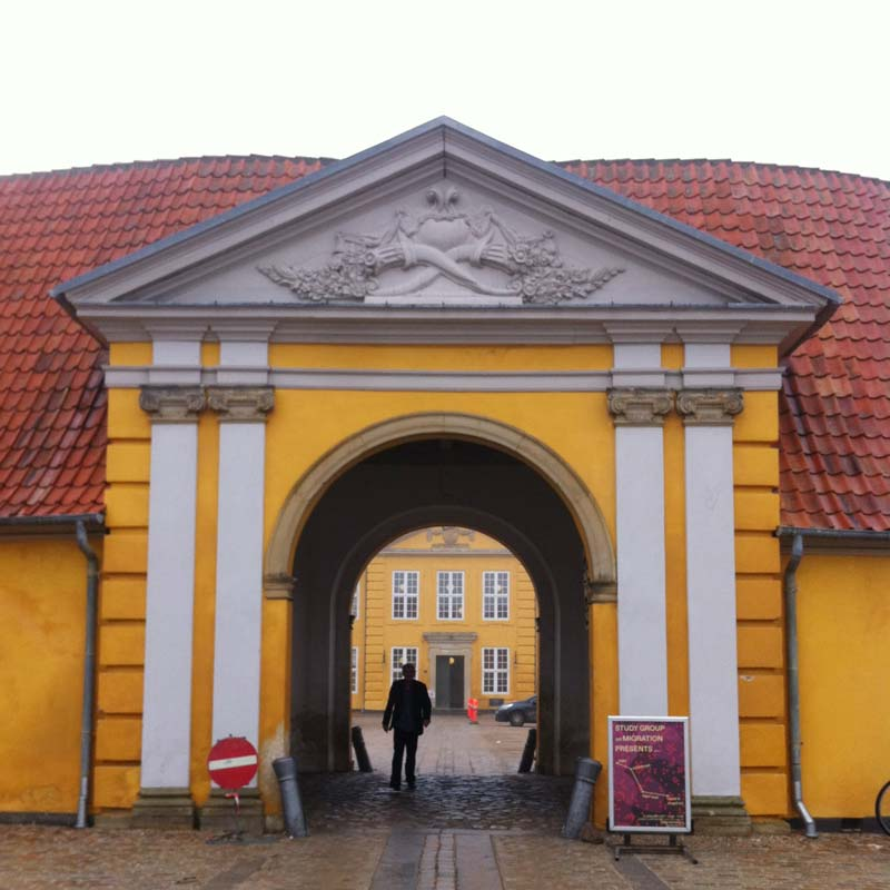 "Entrance of Museet for Samtidskunst Roskilde with the event poster of ""Study Group on Migration Presents"""