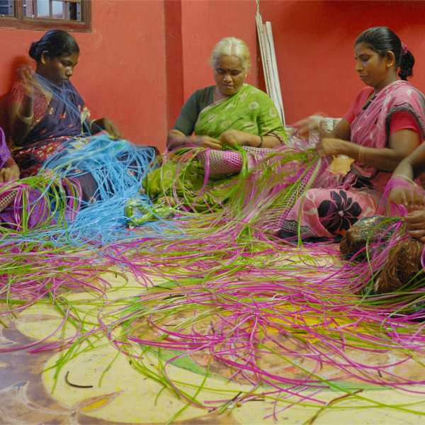 Women in India handweaving the RainTree bag