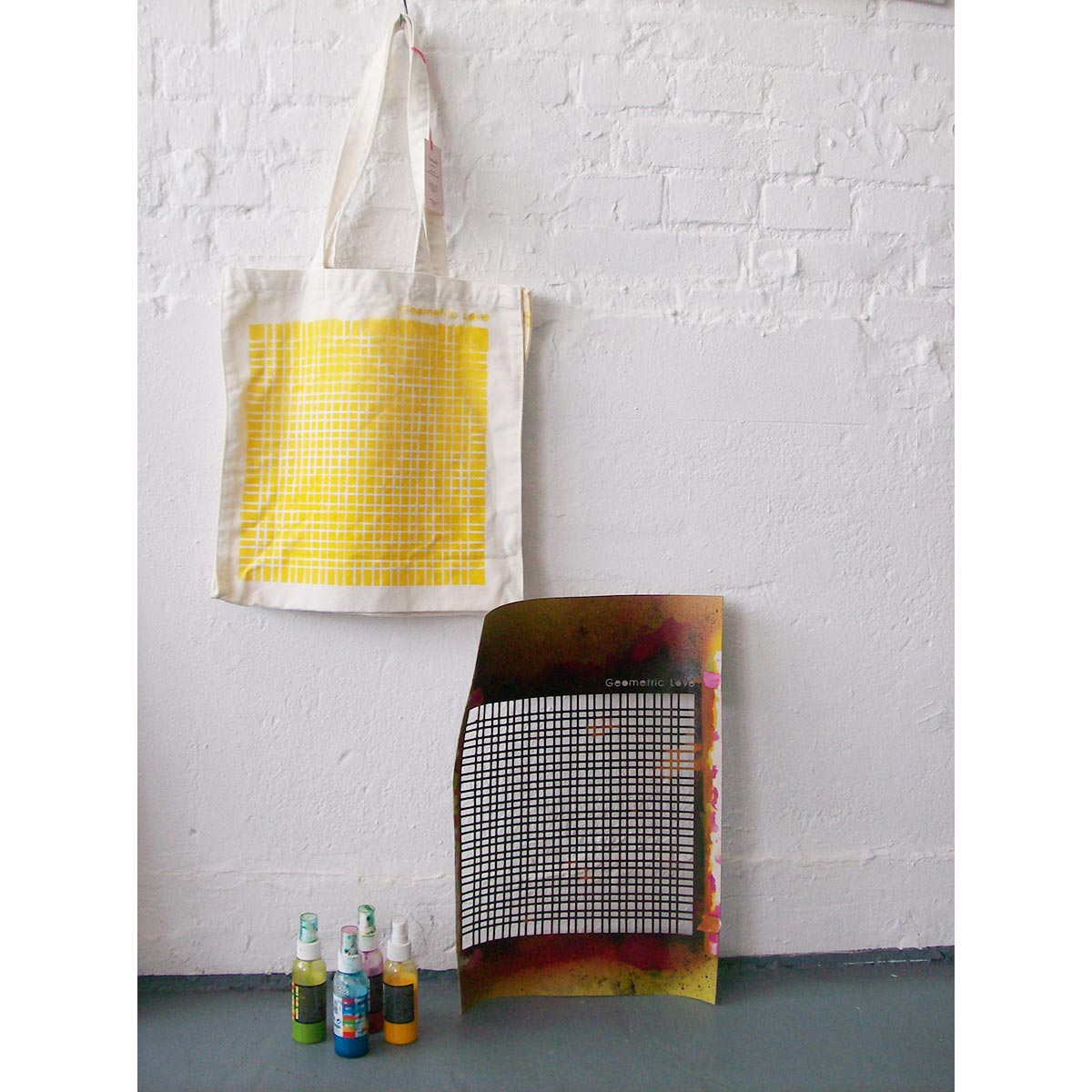 """""""Geometric Love"""" canvas bag with the materials used to paint it"""