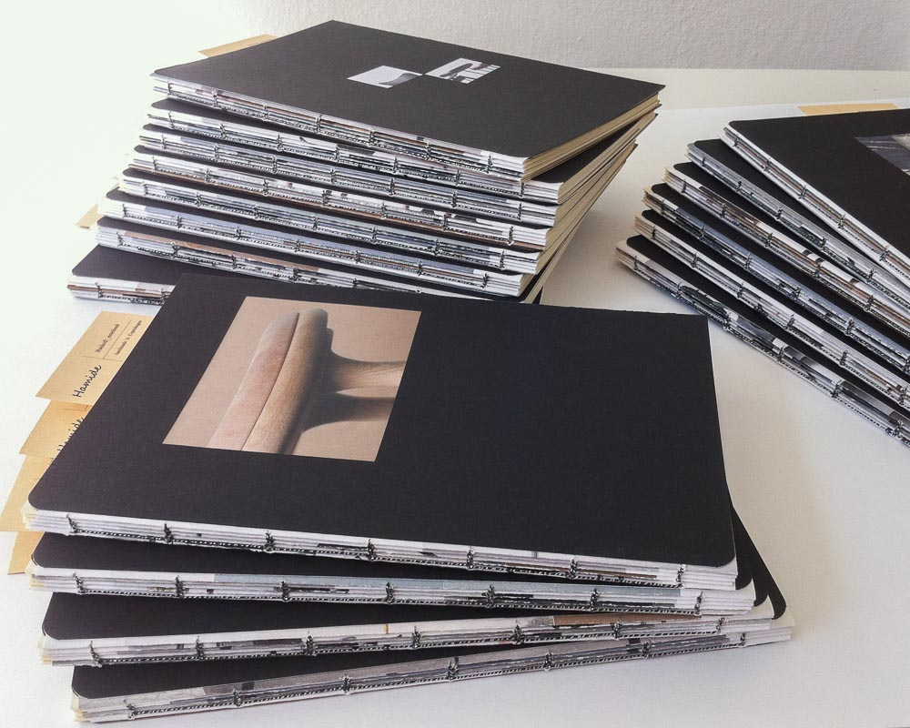"""""""Hacked!"""" notebooks for Mater Earth Gallery stacked"""
