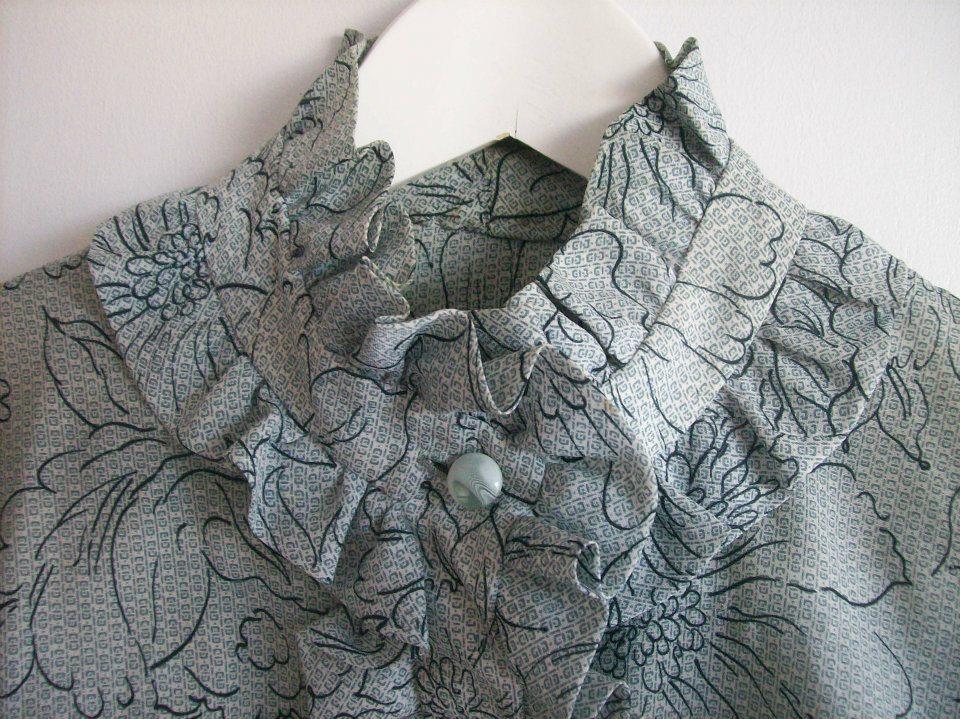 Neckline detail from the grey blouse from Hamide's Originals series