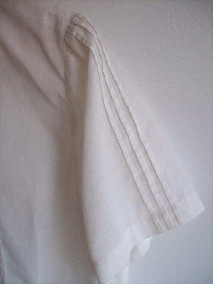 Arm detail from the white blouse from Hamide's Originals series