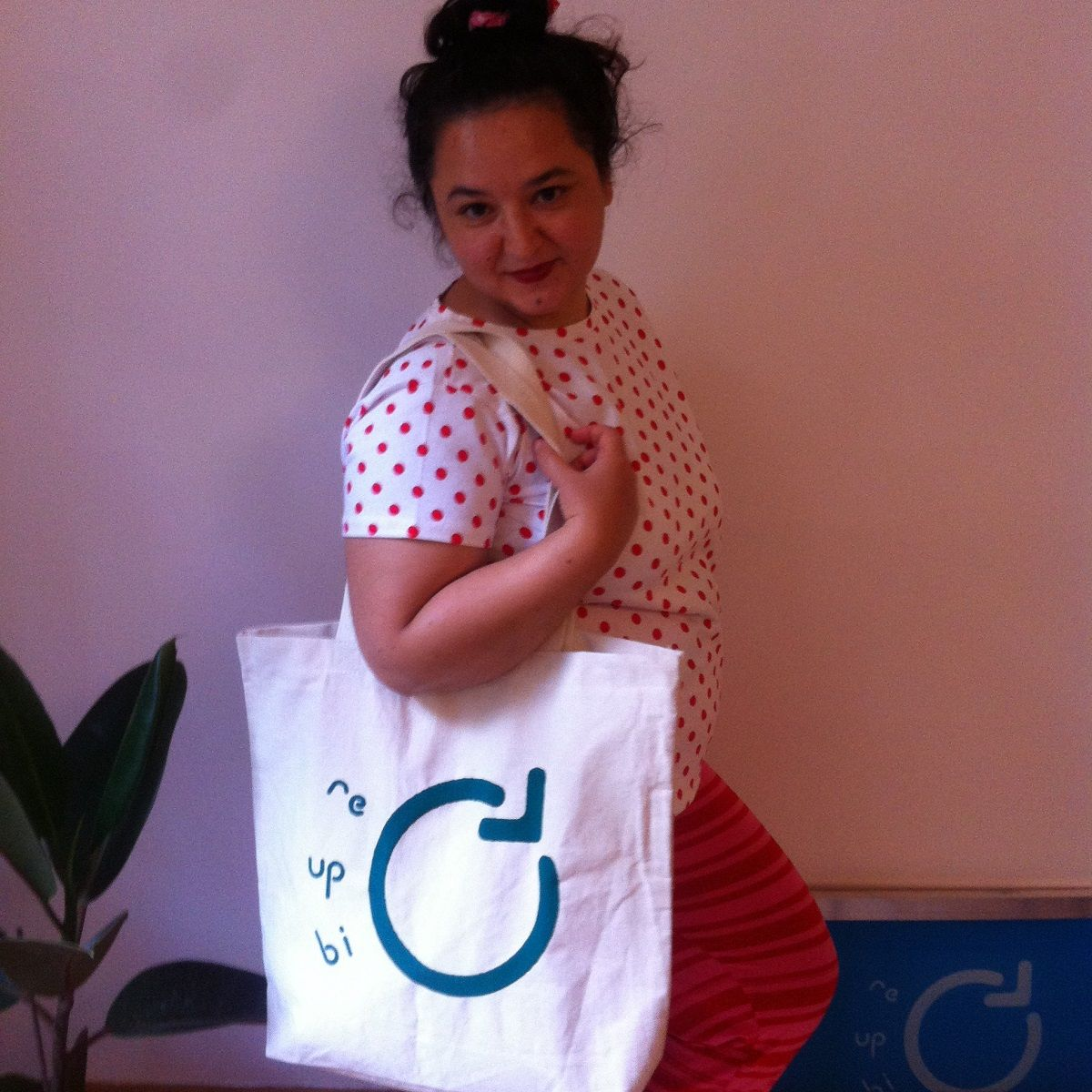Seda wearing the Re-Up-Bi-Cycle Canvas Bag
