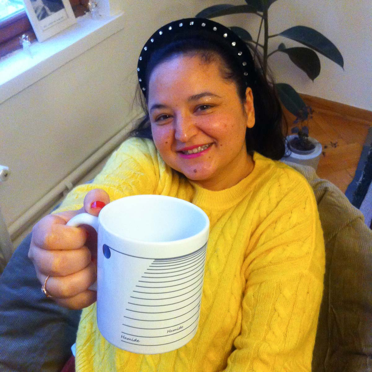 Seda holding the 7th year coffee mug