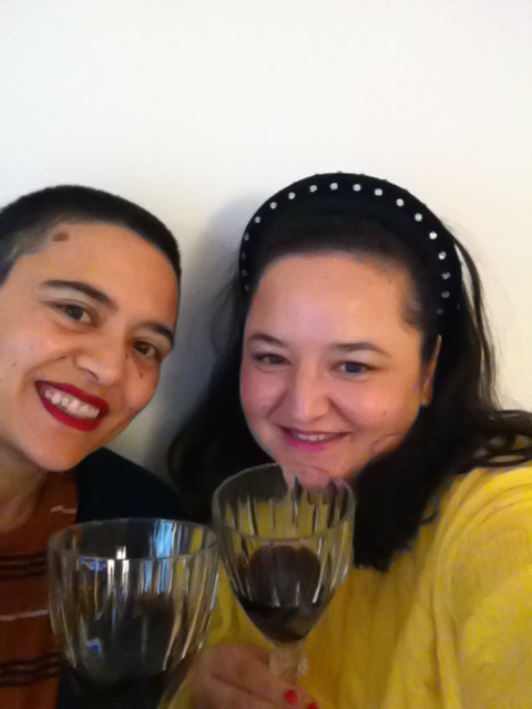 Seda and Seyda in a selfie saying cheers with wine