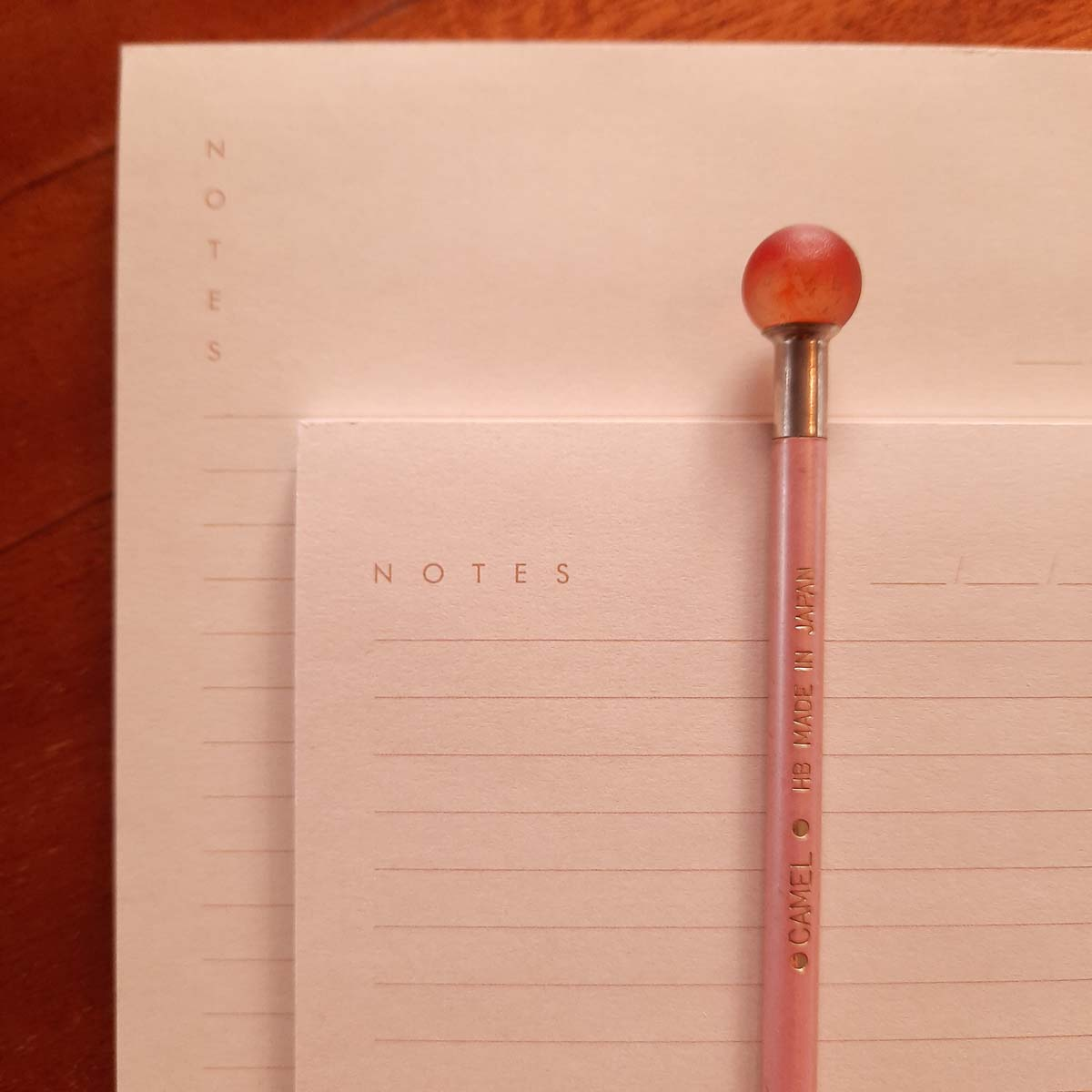 Close-up image of light peach Hamide Basics notepads